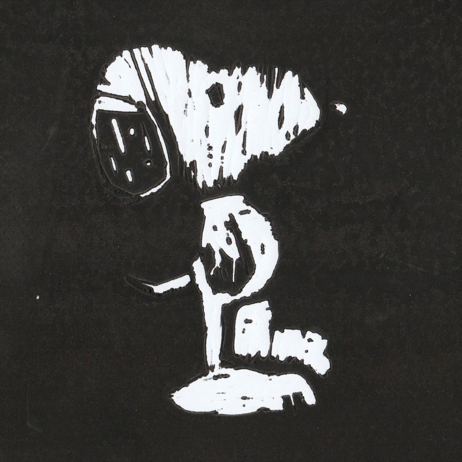 Zīmējumā ir attēlots multeņu varonis vārdā Snūpijs. Pats Snūpijs ir balts, fons ir melns.